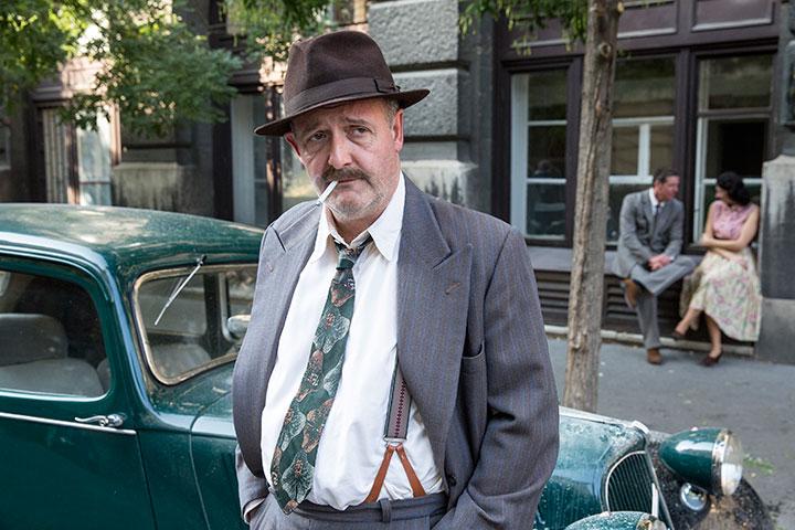 Colin Mace plays Lognon