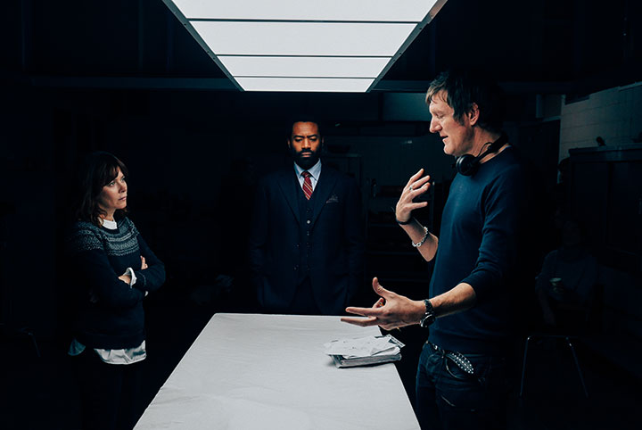 From left: Anna Friel and Charles Pinnock receive direction from Charles Martin