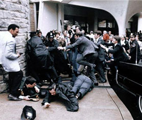 The chaotic scene in the immediate aftermath of the attempted assassination of Ronal Reagan