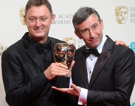 Jeff Pope (left) receiving a Bafta alongside actor Steve Coogan